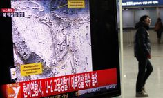 A passenger walks past a television report on North Korea's nuclear test at a railway station in Seoul February 12, 2013. North Korea conducted a nuclear test on Tuesday, South Korea's defence ministry said, after seismic activity measuring 4.9 magnitude was registered by the U.S. Geological Survey. The epicentre of the seismic activity, which was only one km below the Earth's surface, was close to the North's known nuclear test site.   REUTERS/Kim Hong-Ji (SOUTH KOREA - Tags: POLITICS TPX…