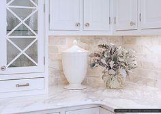 White kitchen cabinets blend with calacatta gold countertop and calacatta gold subway kitchen backsplash tile. Calacatta marble design ideas.