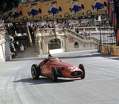Juan Manuel Fangio holds on to a huge slide coming out of Tabac. Formula 1 Monaco 1957 GP.