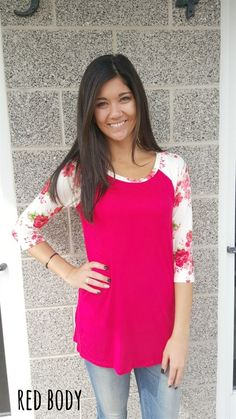 """These cute floral tees will be your new """"go to"""" top! They are so trendy, comfy, flattering and easy to wear! Just think how cute you'll look wearing them out running errands, having lunch with the girls, or just being comfy at home. There are 9 gorgeous colors to choose from. The model is wearing a small."""