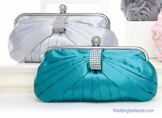 Elegant teal or sky silver clutch style bridesmaids purse or evening bag that features silvertone accents and rhinestones. This evening clutch purse measures 9.5 by 5.25 inches and comes with both a shoulder and wrist strap for ease in carrying. This evening bag is also available in jet black,champagne,sky silver and teal. A nice choice for wedding bridesmaids, mother of the bride or groom or for any special occasion or event. Sure to be a classic dress handbag accessory