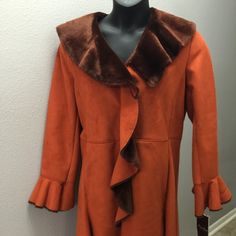 Knee length Terry Lewis Luxuries Collection Coat This looks and feels amazing!  Never worn still has tags. Size marked Medium but more like a Med/Large. Jackets & Coats