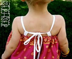 This is a really cute version of the bandana dress. Im going to have to make my girls some of these