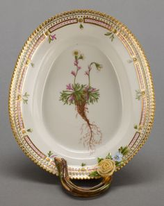 A ROYAL COPENHAGEN FLORA DANICA OVAL HANDLED DISH. 8-3/4 inches long (22.2 cm). The dish inscribed to the bottom Saxifraga decipiens Ehrb g capitosa.