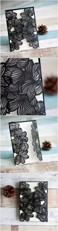 Ivory & black wedding invite with laser cut details.