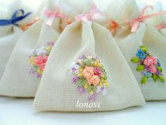 Pretty ribbonwork flowers on sachets.