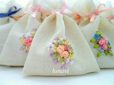 Pretty ribbonwork flowers on sachets.