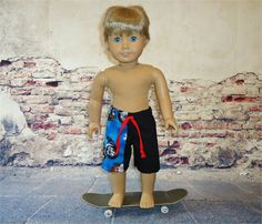 Summer board shorts fitting 18 inch boy doll or girl. American made clothes.  These long skateboard shorts are made from twill with a cotton print side panel. They feature an enclosed elastic waist and a faux tie front.  This pair is black with turquoise blue, red, white and hogs on motorcycles. All seams are professionally finished. Design placement may vary.  SKATEBOARD NOT INCLUDED  *As always, I give a shipping discount on multiple listing purchases. Handmade by me in my pet free and…