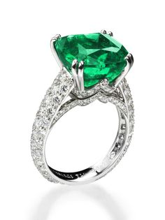 Faberge Solyanka Vera ring in 18ct white gold, set with 129 diamonds totalling 1.81ct. The centre stone is an ethically mined 8.27ct Gemfields cushion-cut emerald