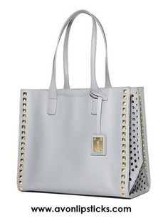We've let the sunshine into our neutral gray tote by adding a bold yellow lining. Add to that on-trend cutouts on both sides, and it's the best fair-weather friend ever! View specs by clicking on image.
