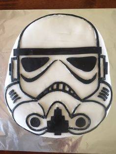 My son's birthday cake I made for him.  Star Wars storm trooper mask.