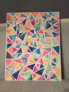"""Water color collage!  I made a few water color paintings in the """"tye-dye"""" style, and cut into random triangles. Use modge podge to attach to a canvas. A cheap project with a beautiful outcome!  Thanks to Kate Bullen for the inspiration"""