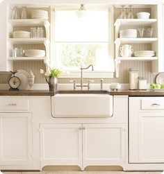 We want to put a farm house sink in when we remodel our kitchen. Love the counter mounted over sink.