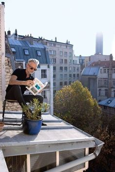 Reading on his roof