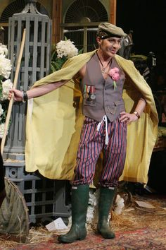 Fashion designer John Galliano brings the stage to life by donning a pair of green Hunter wellies.