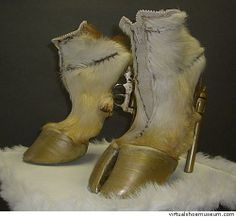 well, if the Horse shoes didn't do it for ya, maybe these goat hooves with guns for the heels might do it!  ;P  Blech!!!