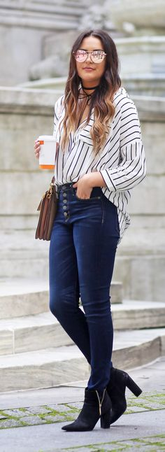 The perfect city look! | Fashion blogger Mash Elle styles a black and white striped top with Hudson high waisted jeans and a pink blush Chloe Faye crossbody bag.