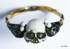 A seventeenth-century English gold and enamel memento-mori ring with a skull at the centre. (Museum of London)