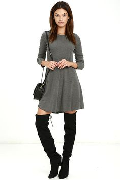 Be prepared for frequent compliments when you've got the Olive & Oak Pardon Me Grey Long Sleeve Dress on! Ribbed stretch knit forms a rounded neckline, long sleeves, and a fitted bodice with lace-up back. Princess seams transition into a lightly flared skirt.