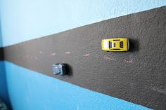 Magnetic chalkboard race track! I painted a stripe of magnetic primer and then chalkboard paint around the boys room and made a racetrack! Then glued magnets to cars and action figures. they draw their own roads with stops signs and train tracks then erase when they are bored of that and draw something else. they LOVE it!