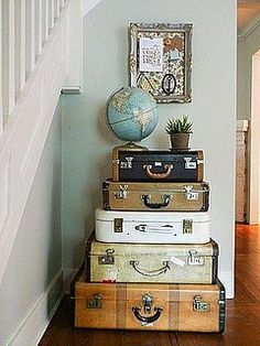 In the corner of our living room stands a stack of suitcases ontop of which is housed a globe-shaped drinks cabinet where I keep my precious single malts hidden.