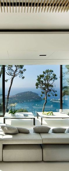 STUNNING VIEW from glass wall of this modern living room overlooking the water