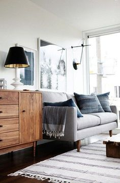 Beautiful gray and blue colors of this living room. The mid century credenza is so gorgeous.
