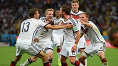 Mario Goetze of Germany celebrates scoring Sunday, 13 July 2014 RIO DE JANEIRO, BRAZIL - JULY 13: Mario Goetze of Germany (C) celebrates scoring his team's first goal in extra time with teammates Thomas Mueller, Andre Schuerrle, Toni Kroos and Benedikt Hoewedes during the 2014 FIFA World Cup Brazil Final match between Germany and Argentina at Maracana on July 13, 2014 in Rio de Janeiro, Brazil. (Photo by Jamie McDonald/Getty Images) | www.dribblingman.com