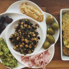 "What my mom used to call ""snack dinner"" was really just antipasto... #antipasto #snackdinner #olives #hummus #guacamole #jalapenochips #thebetterchip #ham #garbanzobeans #dinner #lightmeals #pitapal #glutenfree #dairyfree #celiacdisease #celiac #celiacisalifestyle"