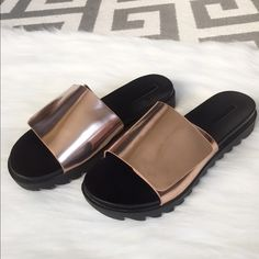 Zara Slides Sporty posh! These slides are oh so stylish and sporty at the same time. The rose gold is a beautiful contrast against the black. 1 1/2 inch platform. Top flap adjustable. Few marks but really not super noticeable since the rose gold is reflective. Worn only a few times last summer. Excellent condition. Zara Shoes Platforms