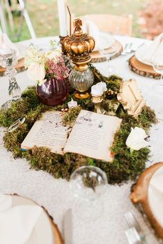 Whimsical Moss and Vintage Book Centerpiece Chelsea Michigan Wedding by Los Angeles Wedding Photographer Loie Photography