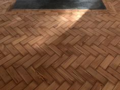 Laid and restored a reclaimed pitch pine parquet. To apply one coat of Woca white lye.