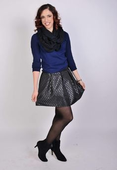 Navy sweater with black flared skirt with black ankle boots.