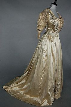 Jeanne Hallée (1880-1914) ball or presentation gown, 1903, with woven label as part of the waistband, `3 Rue Ville L'Eveque', of ivory satin, the bodice and skirt adorned with silver bugle beaded rose trails, the bodice also inset with chemical lace; together with the remains of a Jeanne Hallée pink satin gown with matching embroidered train and an ivory satin skirt,