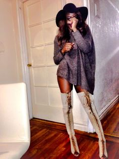 Women thigh high lace up- boots. Love these.