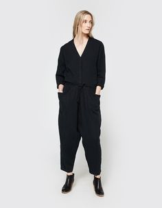 Work wear-inspired jumpsuit in Black Crane in Black. V-neckline. Dropped shoulders. Long sleeves. Concealed button placket. Dropped waist with detachable self-tie belt. Roomy front storage pockets. Gently tapered straight leg. Relaxed fit.  • 100% linen