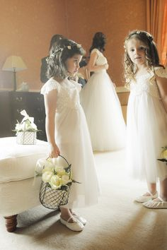 Flower girl dresses by Monsoon. They are do cute! , but I would do them in a different color.