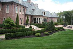 Formal Landscape and Garden Design in Bergen County, NJ: This formal backyard landscaping and garden design in Mahwah , Bergen County , NJ includes Buxus sempervirens (american boxwood), Thuja occidentalis 'Emerald Green' ( emerald green arborvitae), Chamaecyparis obtusa 'Nana' (dwarf hinoki cypress), Pinus strobus 'Nana' (dwarf white pine), Ilex opaca (american holly) and Ilex opaca 'Prostata' (prostrate american holly).