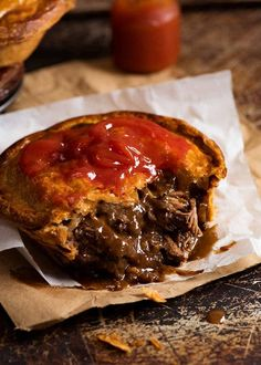 Close up of Meat Pie cut open to show meat pie filling inside, with tomato sauce on top Steak Pie Recipe, Recipe Tin, Meat Pie Pastry Recipe, British Meat Pie Recipe, Quiche Recipes, Meat Recipes, Cooking Recipes, Curry Recipes, Gourmet
