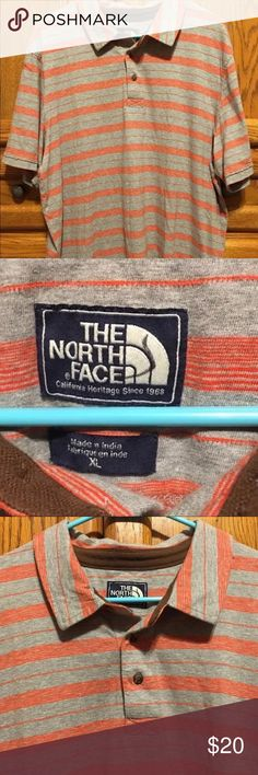 The North Face Mens Vintage Polo Size XL Very good condition. Mens preowned The North Face polo. Grey with orange stripes. No holes or stains. Mens Size Extra Large. There is a marking in permanent marker on the tag as shown in pictures. The North Face Shirts Polos
