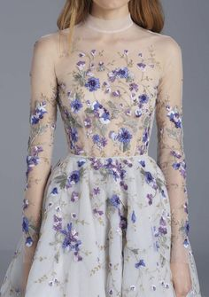 We love the floral pattern on this naked dress!