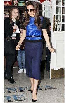 For those who are hesitant about mixing black and blue, take notes on this colorblocked pairing that we first spotted in February. Also, noteworthy: A perfectly placed skinny belt, as seen here, can work wonders on everyone's figure — not just Victoria's.
