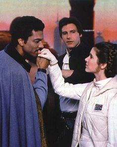 Billy Dee Williams, Harrison Ford, and Carrie Fisher as Lando Calrissian, Captain Han Solo, and Princess Leia Organa in Star Wars: Episode V - The Empire Strikes Back. Star Wars Film, Star Wars Episoden, Star Wars Cast, Harrison Ford, Saga, Princesa Leia, Han And Leia, Lando Calrissian, Star Wars Pictures