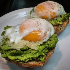 Sous vide poached eggs on parmesan cheese avocado and homemade whole wheat rolls.