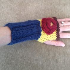 Fingerless mittens Super cute knit mittens I bought off Etsy. Navy, brown, red, and yellow with a gold button. A few loose pieces and a brown mark on the back which I haven't tried to remove. Thanks for looking.💕 Etsy Accessories Gloves & Mittens