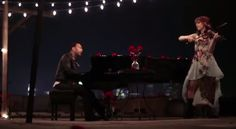 """John Legend collaborated with Lindsey Stirling for a stripped down version of """"All Of Me."""" Watch here: http://www.youtube.com/watch?v=xwsYvBYZcx4"""