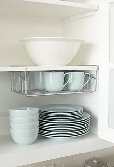 Wire rack is usually used as an inbox in the office, but it works great as an shelf accessory to hold mugs.