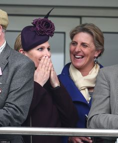Something the matter, Zara?The royal, who was watching the races with a friend wore a chic plum-coloured coat with a high neck, accessorised with thick black gloves and woolly tights while some fellow race goers sported high hemlines and low necklines