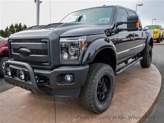 2015 Ford Super Duty F-250 Lariat 4WD Crew Cab 6.7L V8 Diesel Tuscany Black Ops. Pro-Comp lift kit, all-black factory badging, bull bar with KC lights.  Yes, please.