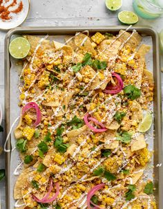 These sheet pan street corn nachos are ridiculously easy and delicious! Grilled corn, chili, lime, tons of cheese and all the flavor you could dream of! Dinner Recipes Easy Quick, Quick Easy Meals, Recipes Dinner, Dinner Ideas, Mexican Food Recipes, Vegetarian Recipes, Ethnic Recipes, Nacho Recipes, Nachos